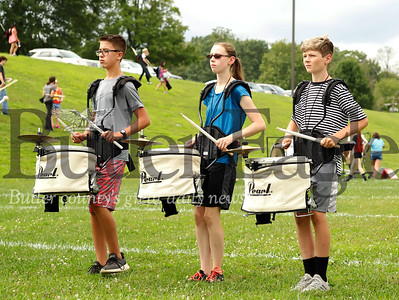 Slippery Rock High School marching band drummers Jacob Anthony(left), Leah Harris, and Nolan Darr warm up at practice Wednesday. Seb Foltz/Butler Eagle 082119