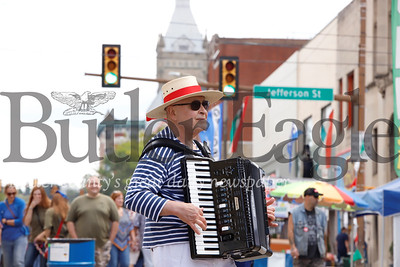 Fresh from Pittsburgh's Italian Festival, Bloomfield resident Hank Edwardo made the trip up to Butler to regale Butler Italian Festival goers with Italian-themed accordion music Saturday. Edwardo said he comes up to yearly for the event which includes street vendors, music, carnival rides and games. Seb Foltz/Butler Eagle