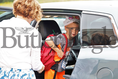 Rowen Schnelle, 5, hops into the family car after being released from Dassa McKinney Elementary School in Moniteau school district Tuesday. Seb Foltz/Butler Eagle
