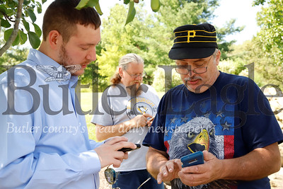 Reid Etherton(Left) Andy Kuntz and Martin Gaynor took advantage of Thursday's sunshine to meet up with  other Pokemon Go enthusiasts to capture a rare Deoxys Pokeman in an EX Raid at Cranberry's North Boundary Park. Most of the crew met through the online game. Seb Foltz/Butler Eagle