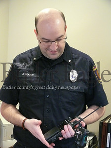 3 COLUMN PHOTO. Jeff Gooch, fire risk reduction coordinator with the Cranberry Township Volunteer Fire Department, shows off new radios being used by the department.