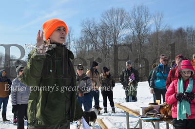 Natalie Simon, an environmental education specialist at Moraine State Park, rallies the crowd of people gathered for Saturday's Groundhog Stomp Hike.  Tanner Cole/Butler Eagle