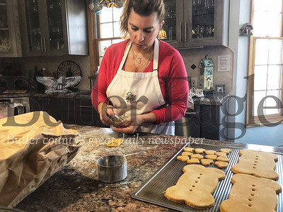 Nancy Hans, owner of Woof Stop Barkery, bakes homemade dog treats and cakes.