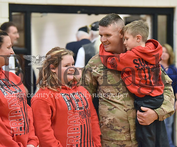 38555 Army Specialist Brian Thompson from Parker surprises his kids Braylynn, 10 and Talon, 6 at Chicora Elementary school after being deployed for almost a year
