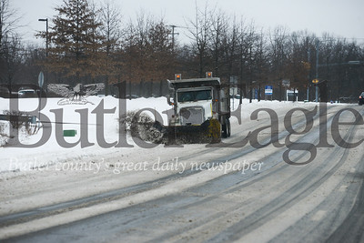 Photos by J.W. Johnson Jr.3: A snow plow clears roads Wednesday in Cranberry Township.