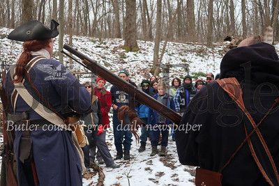 A historical tour group listens to Eric Forster, playing George Washington, and Robin Herne, playing the unknown Native American who historians say tried to kill Washington while he traveled through this area. Tanner Cole/Butler Eagle