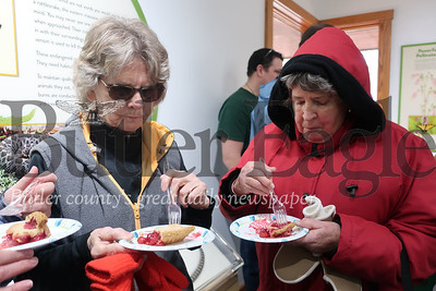 Diane Meyers and Bonnie Keeler celebrate the end of Saturday's Cherry Pie Hike by digging into a couple of slices of cherry pie. Tanner Cole/Butler Eagle