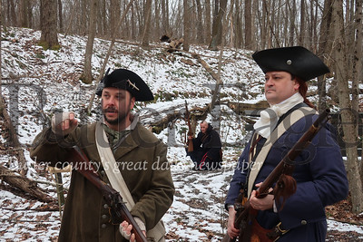 During a history hike at Jennings Environmental Education Center, these three men reenacted an attempt on a young George Washington's life. David Crispen, left, and Eric Forster, right, played Christopher Gist and George Washington respectively. Behind them, Robin Herne readies a rifle to fire at the men while their backs were turned. Tanner Cole/Butler Eagle