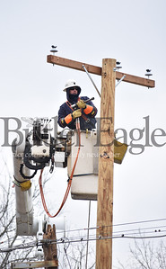 4 Column Photo. A West Penn Power worker puts together a new pole for a power line along Route 8 that was damaged the weekend windstorm. The broken pole occurred by 1905 Pennsylvania 8, Butler, Center Township, PA.