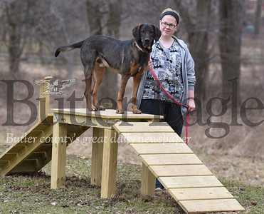 Butler County Humane Society employee Rebecca Morrow takes Cash A Hound Mix through the new Agility trail at the Butler County Humane Society office  on Wednesday February 27, 2019.(Justin Guido photo)