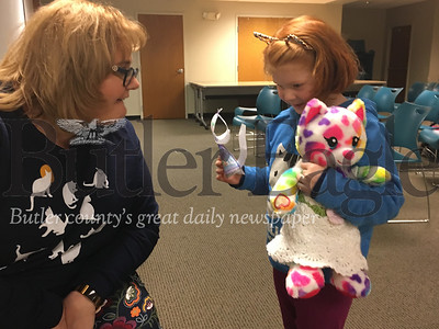 Autumn Dickerman, 6 of Butler, shows off the paper cat she made as part of the Butler Public Library's Happy Mew Year event to Tiffany Harkleroad, the library's youth services librarian. The event took place on Jan. 2, 2019.