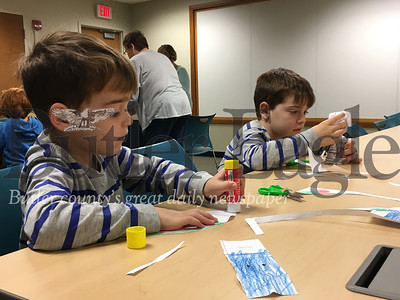 Joey and Anthony Edwards, 4 and 6 respectively of Renfrew,  apply glue to a paper cats they were making as part of the Butler Public Library's Happy Mew Year event. The event took place on Jan. 2, 2019.