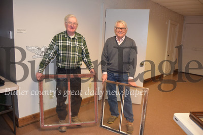Glenn Studebaker (left) gives the old windows from his house, built sometime between the 1820s and 1830s, to Rodney Gasch (right), Historic Harmony president, for the restoration project at the Wagner Haus.Pics by Alexandria Mansfield.