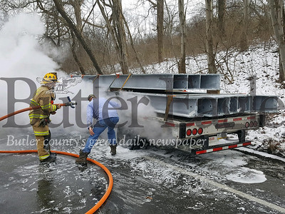 Route 228 West is closed for a quarter-mile stretch between Route 8 and Old Route 8 after tires on a tractor-trailer caught fire around 12:47 p.m. The tractor-trailer flatbed owned by William Brown Trucking in Valencia was carrying steel beams east on Route 228 when a rear tire on the trailer blew .
