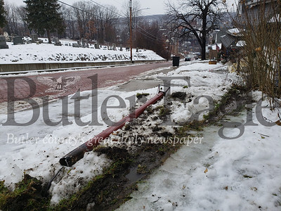 Icy and wet conditions on the brick stretch of S. Main Street caused accidents Wednesday morning. One driver sweeped through two lawns, knocking over two small light poles. Tanner Cole/Butler Eagle