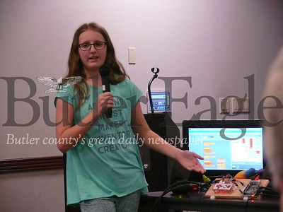Alli Bearer, 10, shows off her inventions Tuesday during a Cranberry Coffee and Conversation event at the township municipal building.