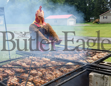 Harold Aughton/Butler Eagle: Harrisville volunteer fireman, Jouhua Burton, attempted to drum up some business for the fire company's fundraiser Saturday, June 29. The volunteers cooked 250 chicken halves during the event.