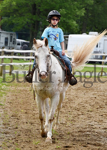 Harold Aughton/Butler Eagle: Emma Snow, 9, of Boyers rides her horse, Charlie, a 12-year-old, Colorado Rangebred, in preparation for the pleasure riding and game competition at the Butler Fair, Saturday, June 29.