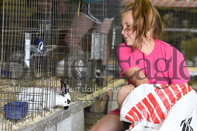 Harold Aughton/Butler Eagle: Emmaline Blatt, 9, of Butler with Layla, an English Spot rabbit, at the Butler Fair, Saturday, June 29.
