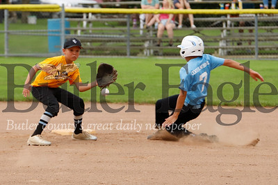 Jaxon Householder beats the throw to shortstop Eli Maze  at second  base for a steal.  The  9-10 year old Seneca Valley North Athletic Association little league Blue Team topped the Gold Team 9-3 in the first round of playoff action Monday night.  The game was called early due to lightening. Seb Foltz/Butler Eagle