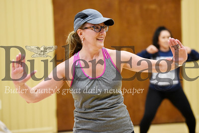 Harold Aughton/Butler Eagle: Ann Marie DePretis of Mars, partiicpates in the Woodland Church excercise class in Mars.