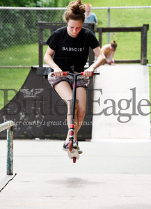 Harold Aughton/Butler Eagle: Cheyenne Gray, 13, of Butler navigates her scooter over the jump at Father Marinaro Park Monday afternoon as part of the Grace Youth and Family Foundation summer outreach program. The program runs from 12 - 3:00 p.m.