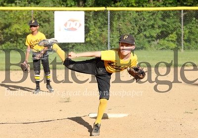 Center Township 9-10 year-old Pirates pitcher Ryan Parson eyes his pitch against the Center Township Angels Monay, July 1. Seb Foltz/Butler Eagle