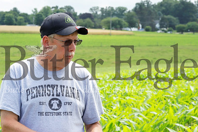 Ed Thiele tours his corn fields describing challenges heavy rains have presented for his corn crop. Seb Foltz/Butler Eagle