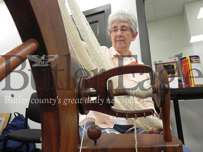Mary Lou Phipps, of Harrisville and Butler Spinners and Weavers Guild member, spins sheep's wool. Photo by Gabriella Canales.