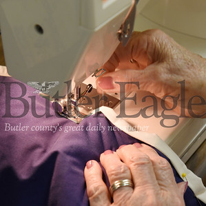 Harold Aughton/Butler Eagle: Eleanor Morris, 91, of Butler puts the final touches on the quilt--sewing it together.