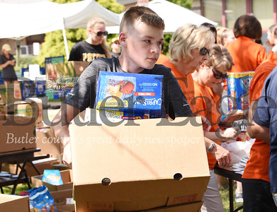 Harold Aughton/Butler Eagle: Riley Green, 14, of Butler volunteered at the Stuff A Bus event sponsored by the Golden Tornado Scholastic Foundation, Tuesday, July 9.