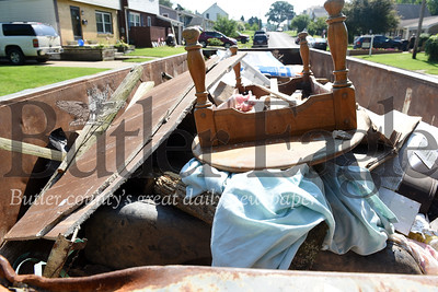 Harold Aughton/Butler Eagle: Residents are now filling up their third container of furniature and other items damaged in the flood.