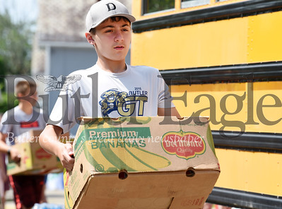 Harold Aughton/Butler Eagle: Saxon Soner, 14, of Butler Volunteered Tuesday at the Stuff A Bus event sponsored by the Golden Tornado Scholastic Foundation.