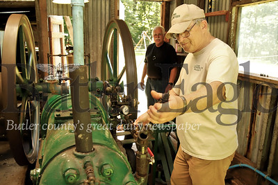 DCNR volunteer John Chos operates a late nineteeth, early twentieth century Bessemer gas engine at the Muddy Creek Oil Field in Morraine State Park. The restored oil field operated from the late 1800s to the 1960s. Visitors can see monthly demonstrations of one of the original engines that once alternated pumping of 19 to 29 nearby oil wells. The oil wells and a small museum are located on the southeastern edge of Morraine State park. Volunteers will staff the site August 10, Sept. 14, and Oct. 12.  Seb Foltz/Butler Eagle