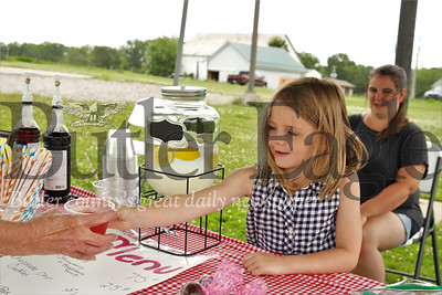 With her mom Kaity supervising, Gianna Shwallon serves up some fresh lemonade at her lemonade stand. Seb Foltz/Butler Eagle