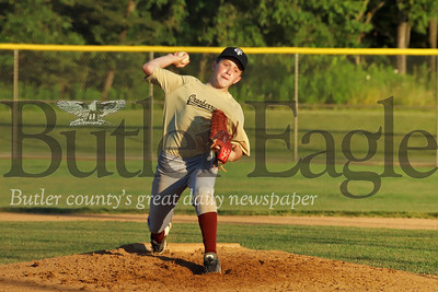 Jimmy Price of the 13-14 year-old Cranberry travel team winds up for a pitch against Etna Monday evening at Grahm Park in Cranberry. Seb Foltz/Butler Eagle