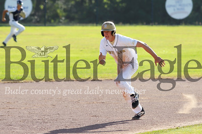 Kyle Weitzel breaks toward third base against Freeport Tuesday evening. Seb Foltz/Butler Eagle