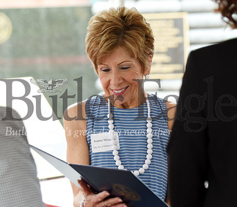 Harold Aughton/Butler Eagle: Joanne Meredith, board president of the ARC of Butler County, reacts to one of the many proculamations Wednesday during a celebratrion in Diamond Park.