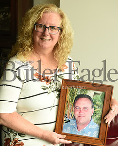 Harold Aughton/Butler Eagle: Holly Moore holds a photo of her husband Michael.