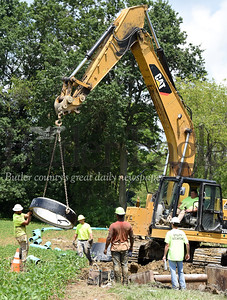 Harold Aughton/Butler Eagle: Workers from Pollard Land Services, Inc. replace 8'' clay sewer lines with new 12'' pvc near main street in Saxonburg Thursday afternoon. According to authority manager Paul Cornetti, the project is slated to replace 3,000 feet of lines from main street to to Butler and Water streets. The cost of the project is $342,000