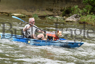 Harold Aughton/Butler Eagle: John George of Greensburgh and his dog, Logan, participated in the Allegheny Aquatic Alliance second annual canoe/kayak race on the Connoquenessing Creek Saturday. The .7.5 mile race began along Porter's Cove Road near Harmony and finished in Fombell at Chritian's Canoe Launch.
