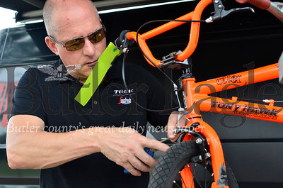 Jim Bilka, manager of Trek Bicycle Cranberry, tunes up a bike at the fifth annual Cranberry Township Bike Rodeo at Community Park.