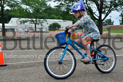 Penny Fulton, 6, of Cranberry Township rides her bicycle through the course at the fifth annual Cranberry Township Bike Rodeo at Community Park.