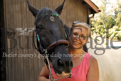 Kim Dugan of Evans City and one of her horses. GED Community story. Seb Foltz/Butler Eagle