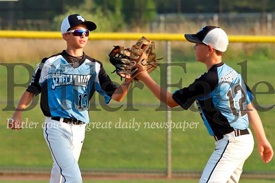 Seneca Valley/Cranberry 13U second baseman Chase Lauer (left) gets a high five from Nick Parrotto. Lauer initiated a double play to end the fourth inning during tournament play against Ohio Prospects at Grahm Park in Cranberry Friday. Seb Foltz/Butler Eagle