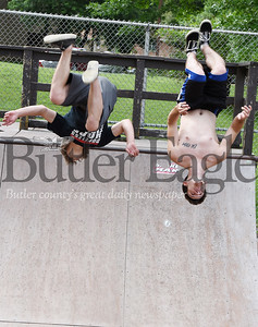 Harold Aughton/Butler Eagle: Zachery Everetts, left, and Danny Duncan of Butler practice backflips in Father Marinaro Park Monday, July 22, 2019.