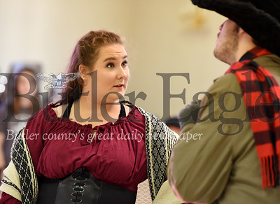 Harold Aughton/Butler Eagle: Ruby Shearer of Cabot addresses Draven Stuart of Butler during a recent rehersal of Oliver at St. Peters Roman Catholic Church.