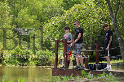 Mason Hoey, 12, (left) Riley Doutt, 14, and Brady Lyon, 13, enjoy an afternoon fishing session at Carrie's Pond in Preston Park. Seb Foltz/Butler Eagle 7/23/19