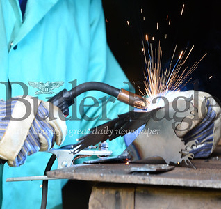 Harold Aughton/Butler Eagle: Life Boy Scout, Edward Ditch, 14, of New Castle welds the wing onto his eagle  at Camp Bucoco.