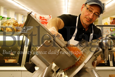 Viola's owner Frank Viola slices some deli meat for a customer. Seb Foltz/Butler Eagle